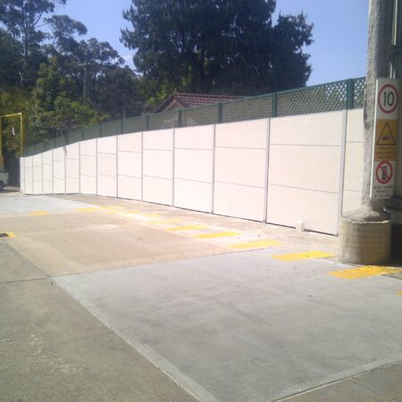 DuneWall with AcoustX Panel by Wallmark Australia bolted to concrete 2.4m high at Mitsubishi Sydney NSW