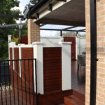 UrbanWall with AcoustX and timber feature panelling by Wallmark. 2.1m high at Albury, NSW