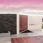 UrbanWall with AcoustX, slat infill and stone featured panelling by Wallmark Australia. 2.1m high at Wodonga VIC